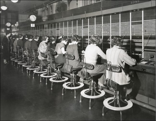 Telephone operators using a switchboard in the 1930s.