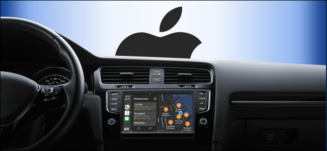Apple CarPlay on a vehicle's infotainment screen with the Apple logo looming outside the windshield.