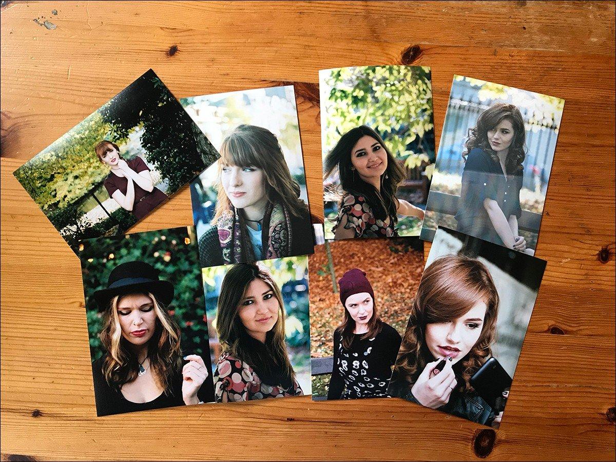 Physical photos spread out on a table.
