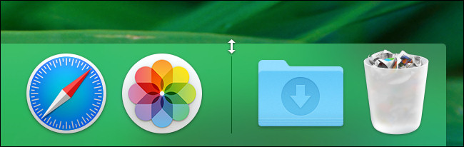 In macOS, hover your mouse pointer over the divider line in the Dock until it changes into a resize arrow.